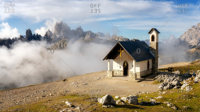 October 10, 2019: Small church with the Cadini di Misurina mountain range in the background, Dolomites, Italy, Europe
