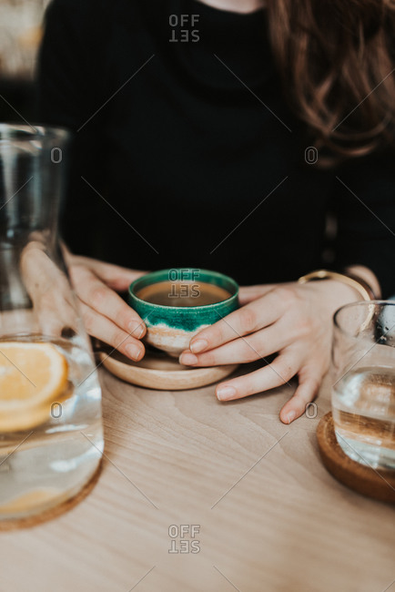 Close up of woman drinking espresso in a cafe