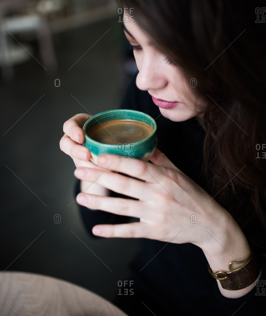 Close up of woman drinking espresso