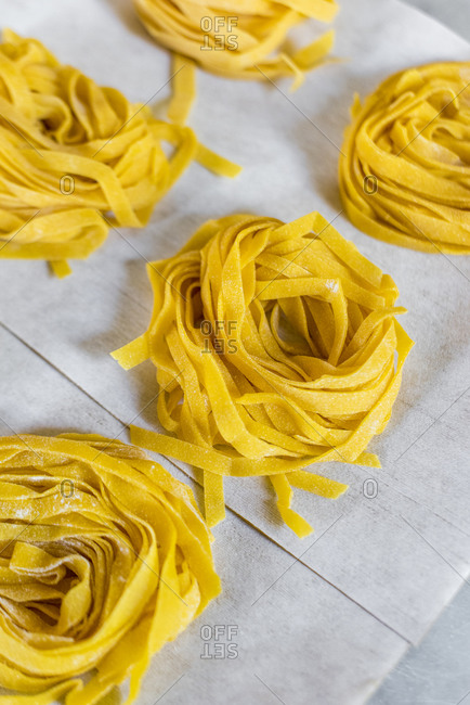 Round bunches of fresh homemade Tagliatelle pasta