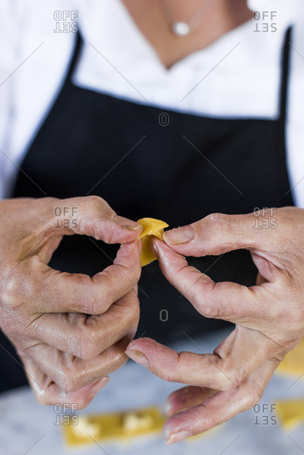 Close up of an Italian woman making homemade tortellini