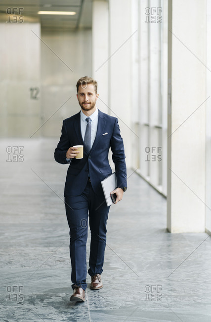 Portrait of businessman with takeaway coffee on the go