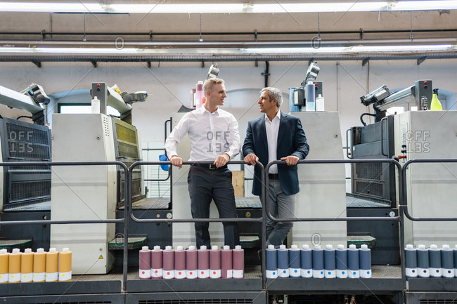 Two businessmen talking in a printing shop