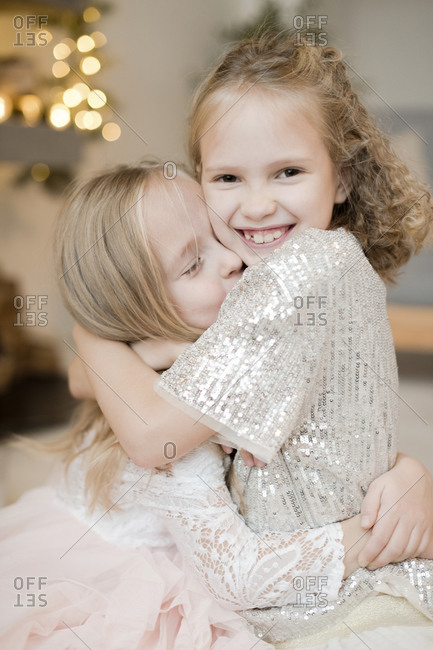 Portrait of two happy little girls hugging each other