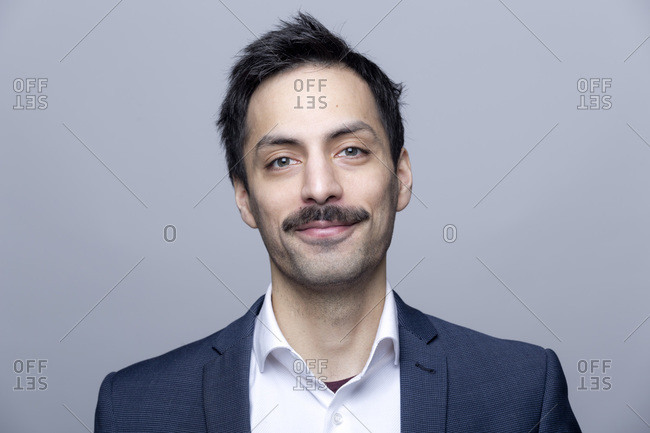Portrait of smiling businessman with moustache
