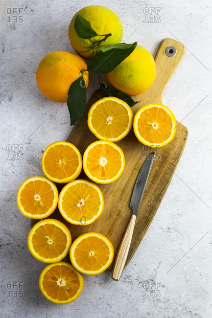 Freshly cut oranges on cutting board