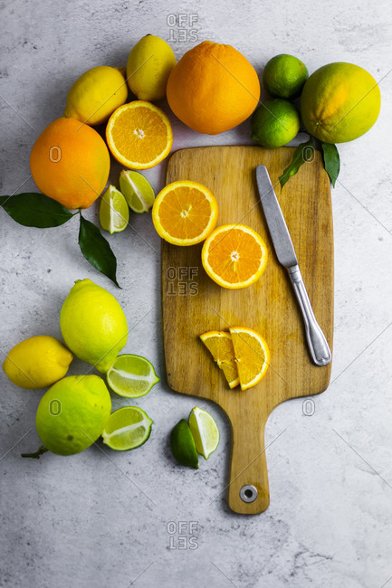 Cutting board- kitchen knife and various citrus fruits