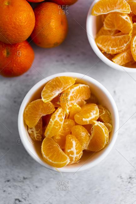 Bowls of freshly peeled mandarines