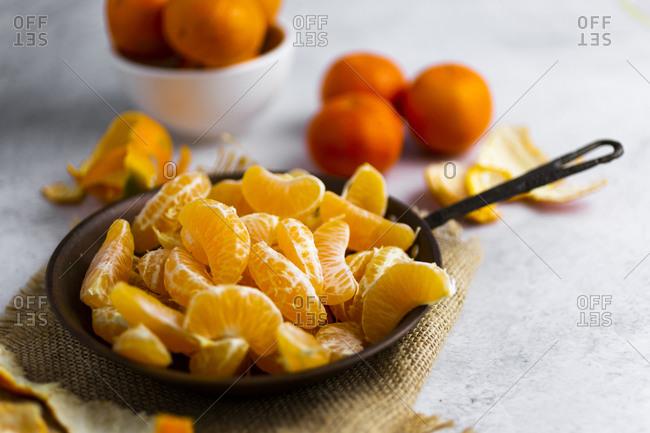 Heap of freshly peeled mandarines on frying pan
