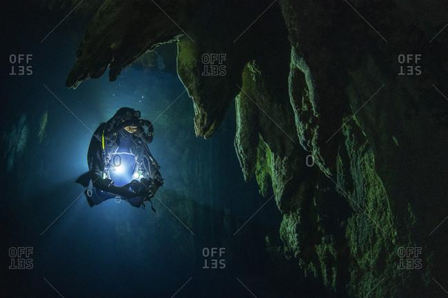 Palau- Koror- Diver exploring Chandelier Cave
