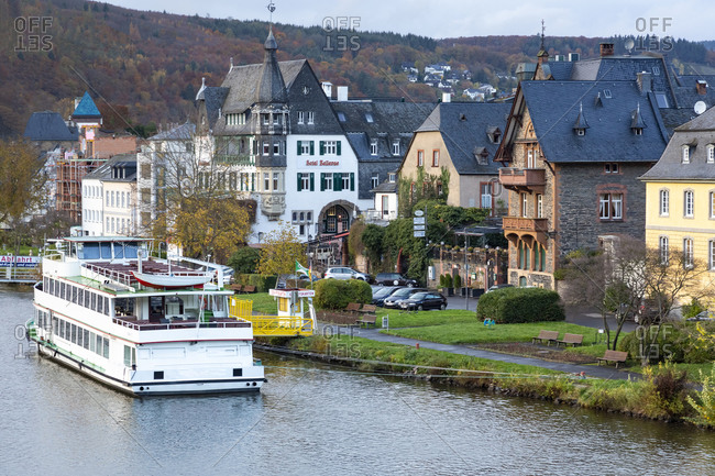 November 12, 2019: Germany- Rhineland-Palatinate- Traben-Trarbach- Ferry moored in front of houses of riverside town