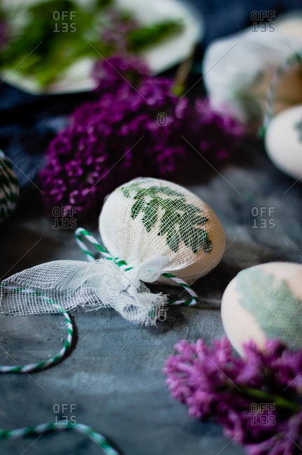 Close-up of Easter egg in gauze ready to be naturally dyed with plant material