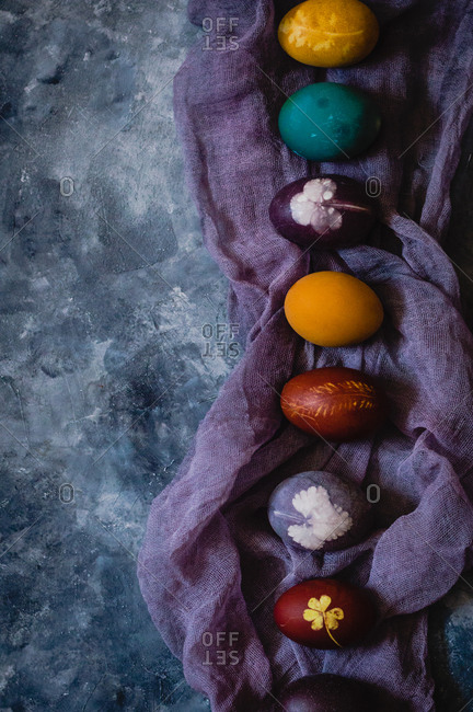 Overhead view of naturally colored Easter eggs with wine, turmeric, onion peelings, red cabbage