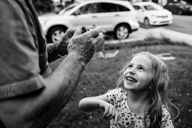 A little girl looks up at her grandfather.