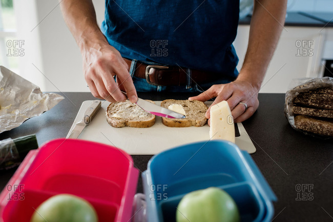 Dad making a packed lunch for his kids before school