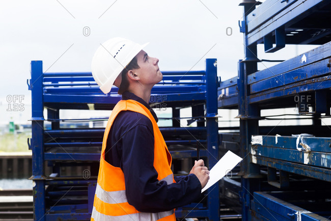 Worker young male controlling shelf