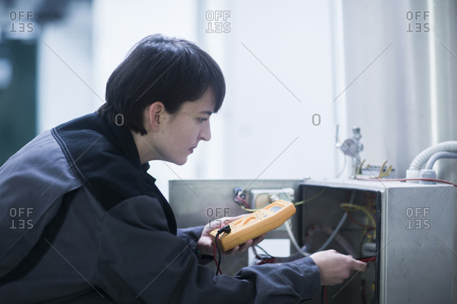 Worker young male checking tool