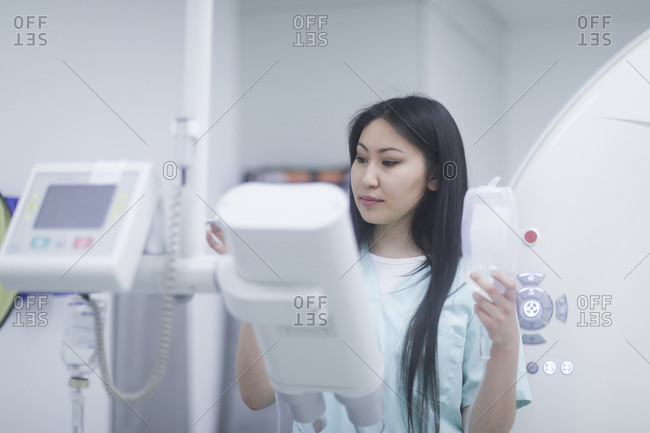 Asian woman doctor with tablet in a hospital