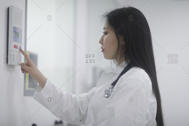 Asian woman doctor with tools in a hospital