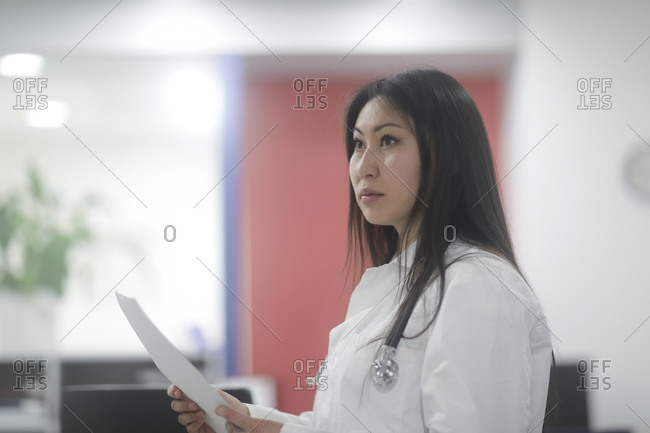 Asian woman doctor checking protocol in a hospital