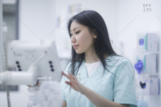 Asian woman doctor checking paper in a hospital