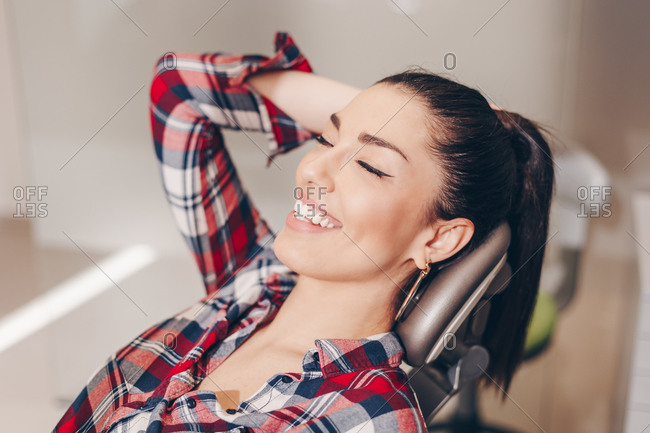 Attractive woman with healthy teeth waiting for an examination.