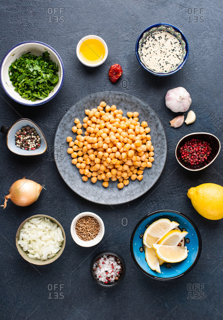 Ingredients for cooking falafel. Chickpea, sesame, garlic, lemon, onion, chopped greens, spices