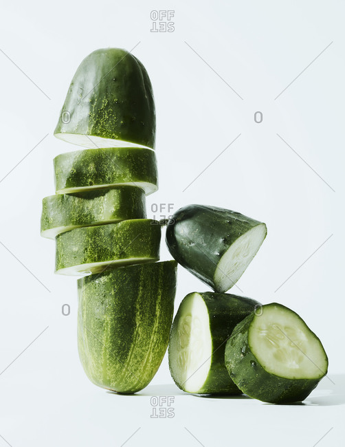 Cucumber still life on light blue surface