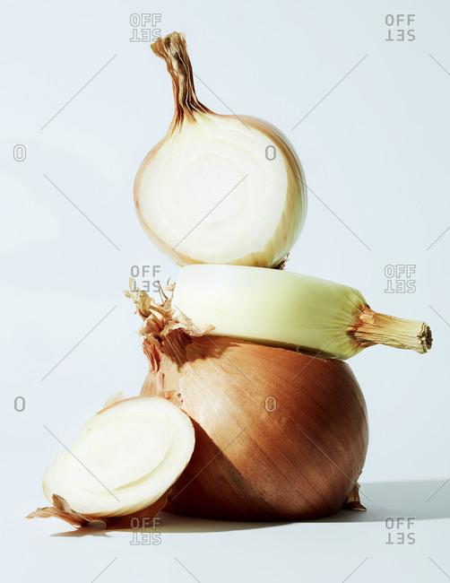 Sliced onion still life on light blue