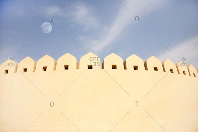 Moon over the exterior wall of the Jantar Mantar Astrological Park, Jaipur, India