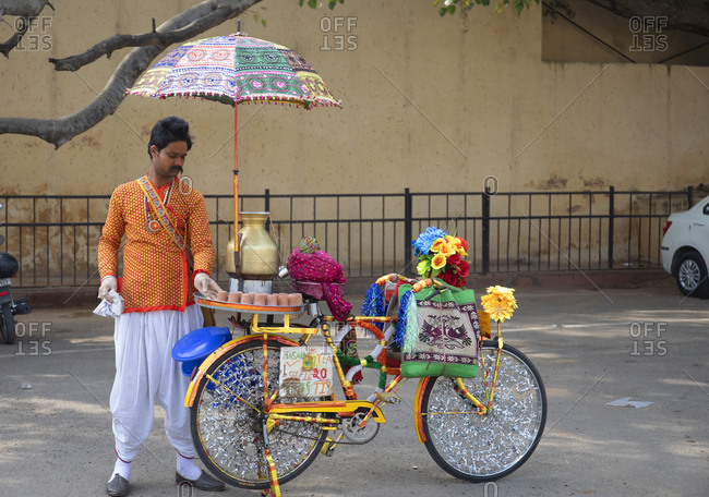 Jaipur, India - January 3, 2020: Man setting up mobile tea shop on bicycle, Jaipur, India