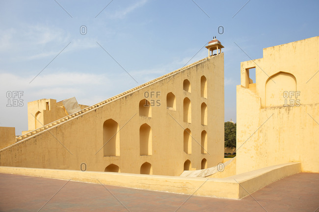 Yellow structures at the Jantar Mantar Astrological Park used to observe the stars and measure time in Jaipur, India