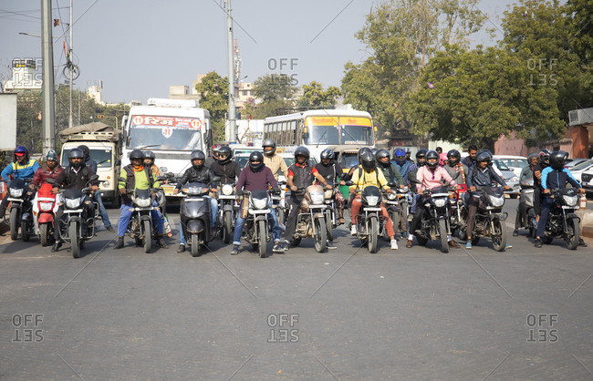 Jaipur, India - January 4, 2020: Motorcycles waiting at red light in morning rush hour, Jaipur, India