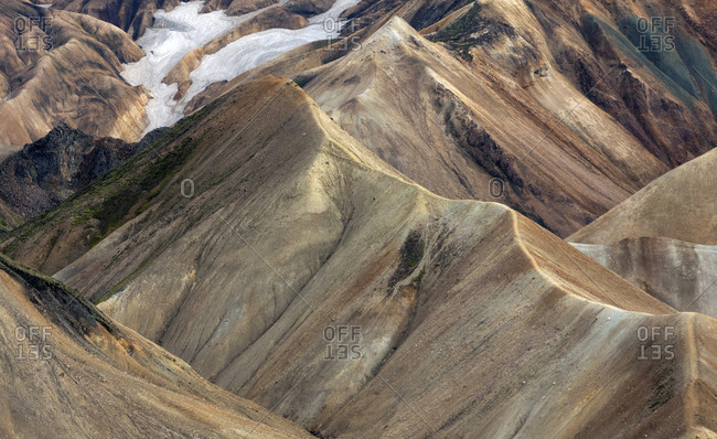 Scenic view of majestic colorful mountain ridges in cloudy day in Iceland