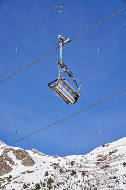 From below of cable car moving from mount station on right to station on left high above in Candanchu, Huesca, Spain
