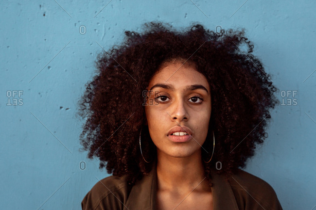 Young black woman looking at camera with intense look