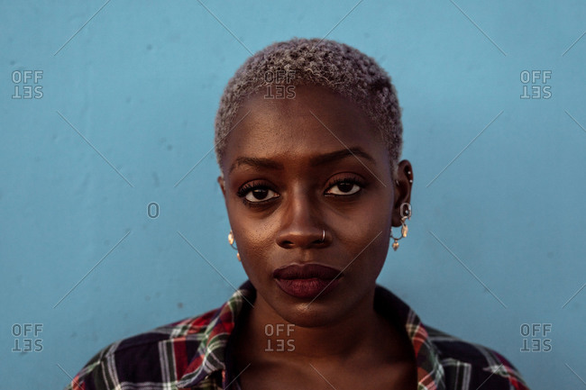 Young black short haired woman looking at camera with intense look