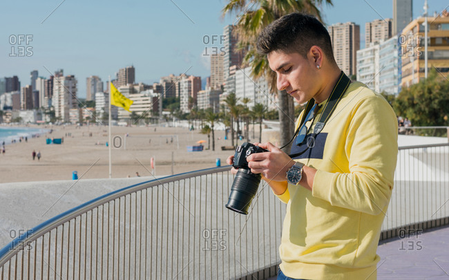 Creative young photographer shooting on waterfront