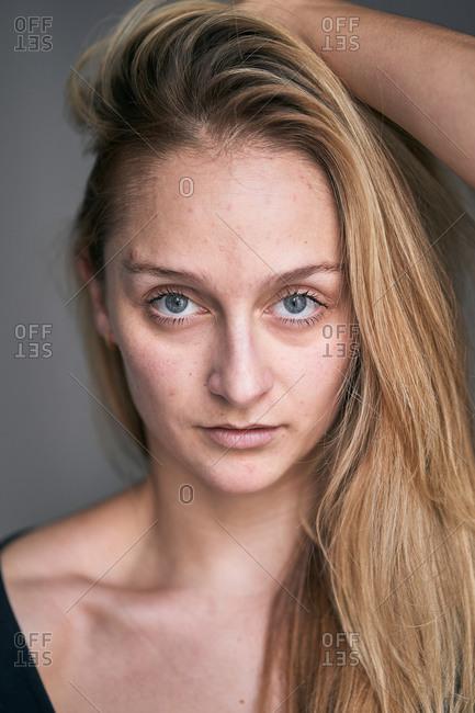 Blond female model in studio