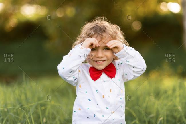 Overjoyed male child having fun in green park