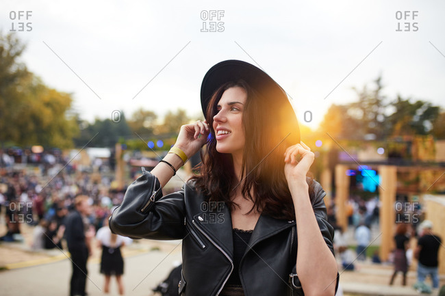 Long haired tender beautiful woman thoughtfully looking away in bright day in park at festival