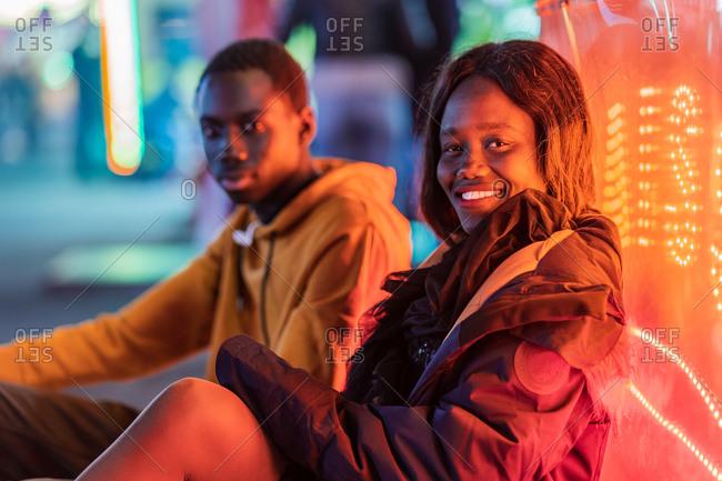 Black couple resting on fairground