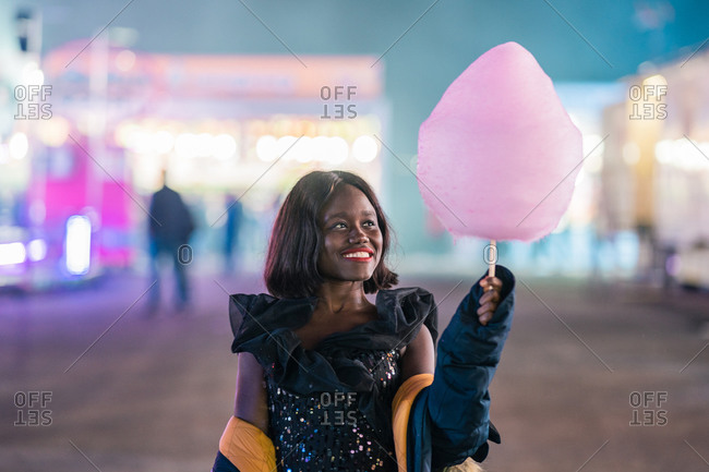 Cheerful African American woman with cotton candy