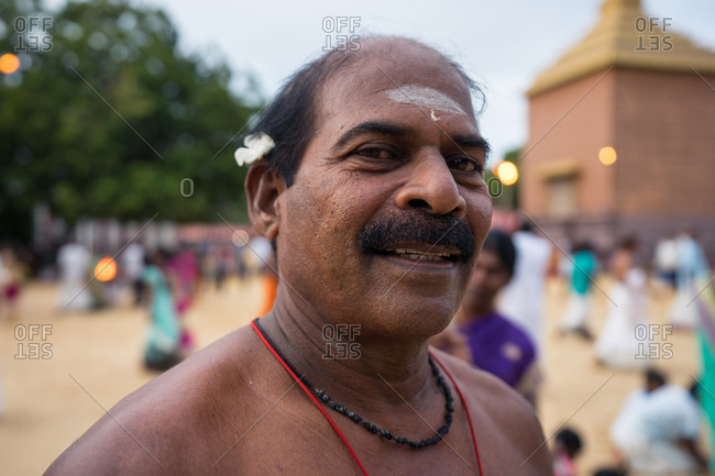 Jaffna, Sri Lanka - August, 9 2019: Adult Hindu man with moustache smiling and looking at camera while visiting Nallur Kandaswamy Kovil Festival