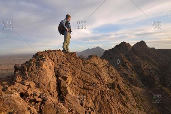 Hiker standing on top of Mohawk Mountains, Arizona, USA