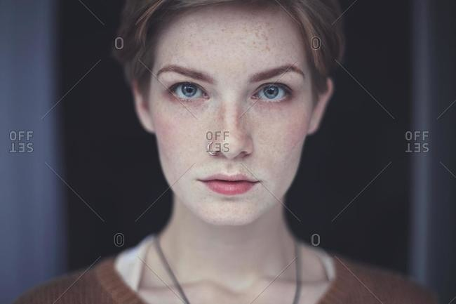 Portrait of beautiful woman with short hair and a nose piercing