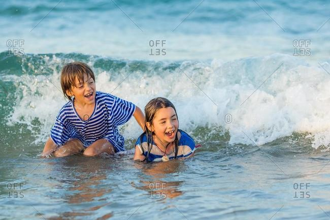 Two happy children playing in the sea
