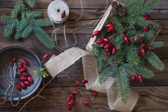 Rosehip, fir branches, ribbon and string for making Christmas decorations