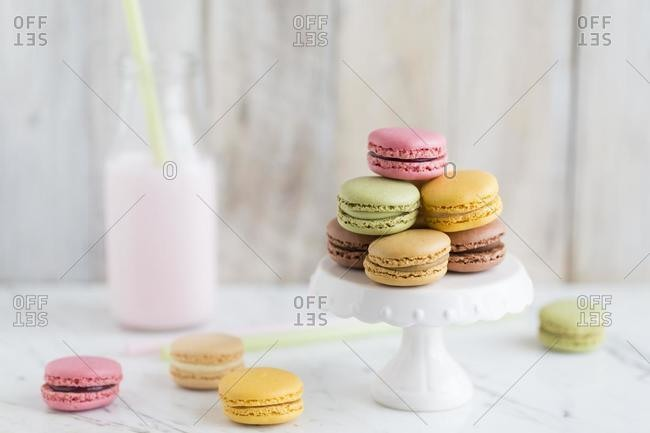 Bottle of milk and macaroons on a marble table