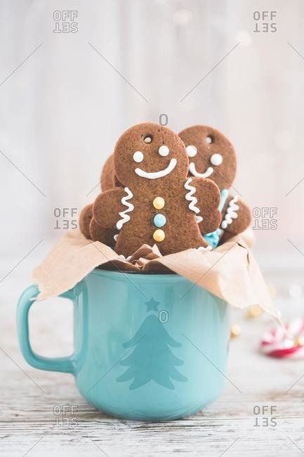 Gingerbread man cookies in a Christmas mug
